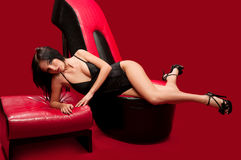 Beautiful woman lays on the couch Stock Images