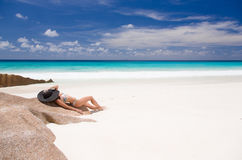 Beautiful woman lays on the sandy beach of Seychelles Royalty Free Stock Photo