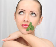 Beautiful woman with leaf Stock Photography