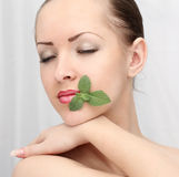 Beautiful woman with leaf Royalty Free Stock Photos
