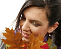 Beautiful woman with a leaf stock photos