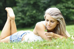 Beautiful woman with a leaf clover Stock Photo
