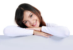 Beautiful woman leaning on blank board Stock Images