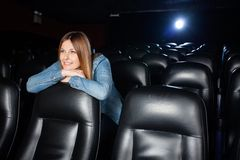 Beautiful Woman Leaning On Seat At Cinema Theater Stock Photos
