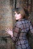 Beautiful woman leaning on wall Royalty Free Stock Photography