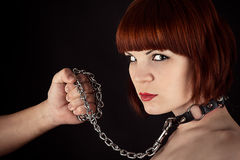 Beautiful woman on a leash Royalty Free Stock Photos