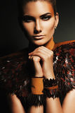 Beautiful woman in leather accessories. In dark Royalty Free Stock Photography