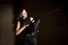 Beautiful woman in leather clothing holding saber royalty free stock photo