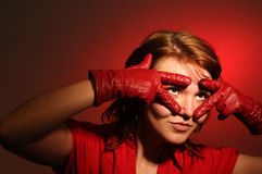 The beautiful woman with leather gloves Royalty Free Stock Image
