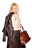 Beautiful woman with leather jacket and bag posing Stock Photo