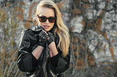 Beautiful woman in a leather jacket. Beautiful blonde woman in a leather jacket Stock Photos