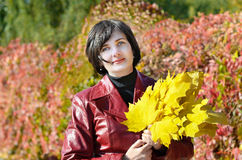 Beautiful woman with leaves. Beautiful woman with yellow leaves Royalty Free Stock Photo