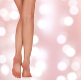 Beautiful woman legs on an abstract background Stock Images