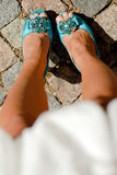 Beautiful woman legs in blue high heel shoes Stock Images