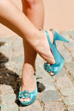 Beautiful woman legs in blue high heel shoes Royalty Free Stock Photo