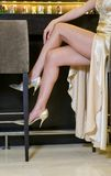 Beautiful woman legs in a cocktail bar Royalty Free Stock Photo