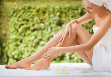 Beautiful Woman Legs And Cream. Stock Photo