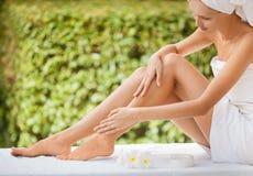 Beautiful Woman Legs And Cream. stock photo