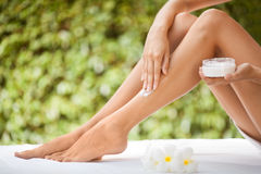 Beautiful Woman Legs And Cream. Stock Photography