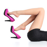 Beautiful woman legs with a fuchsia high heels dangling Royalty Free Stock Photos