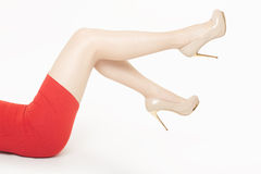Beautiful woman legs with high heels shoes. And red dress on white, clipping path included royalty free stock photography