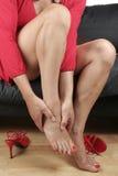 Beautiful woman  legs  massaging  feet Royalty Free Stock Photography