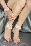 Beautiful woman   legs over satin fabric Royalty Free Stock Photo