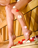 Beautiful woman legs with petals Royalty Free Stock Photos