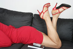 Beautiful woman  legs with  red dress Royalty Free Stock Photo