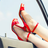 Beautiful woman legs. In red high heels at the car Royalty Free Stock Photo