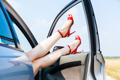 Beautiful woman legs. In red high heels at the car Royalty Free Stock Photography