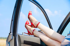 Beautiful woman legs. In red high heels at the car Stock Images