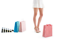 Beautiful woman legs with shopping bags Royalty Free Stock Image