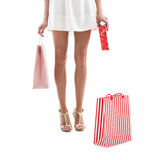Beautiful woman legs with shopping bags Stock Photography
