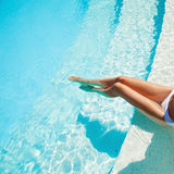 Beautiful woman legs in swimming pool. Royalty Free Stock Photo