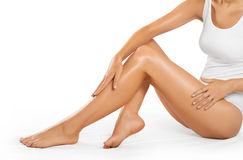 Beautiful woman legs on a white background. stock images
