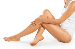 Beautiful woman legs on a white background. royalty free stock image