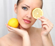 Beautiful woman with lemon Stock Image
