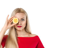 Beautiful woman with lemon in her hand Stock Photo