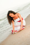 Beautiful woman with letter in bottle. Have a dreams Royalty Free Stock Photo