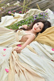Beautiful woman lie down with flowers outdoor Royalty Free Stock Photos