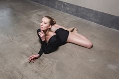 Beautiful woman lie in floor and stretching. Stock Image