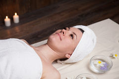 Beautiful woman lies in the sauna spa relax. Massage Stock Photo