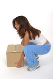 Beautiful Woman Lifting Box 1 Royalty Free Stock Photography