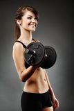 Beautiful woman lifting dumbbell Stock Photos