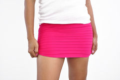 Beautiful woman lifts up pink mini skirt Stock Photo