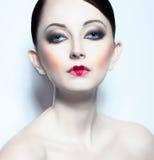 Beautiful woman like doll with a glamorous cool ma Stock Photo