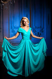Beautiful woman like a princess in the palace. Luxurious rich fa Stock Photography
