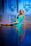 Beautiful woman like a princess in the palace. Luxurious rich fa Stock Photos