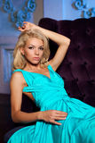 Beautiful woman like a princess in the palace. Luxurious rich fa Royalty Free Stock Photo